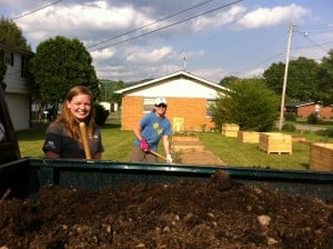 Hannah (left) and Laura (right) unloading compost into the raised beds at the Barbourville Community Garden.