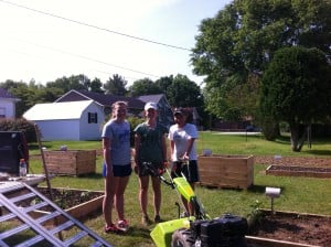 Hannah, Laura, and Kathryn with their tiller, Alice, at the Barbourville Community Garden.