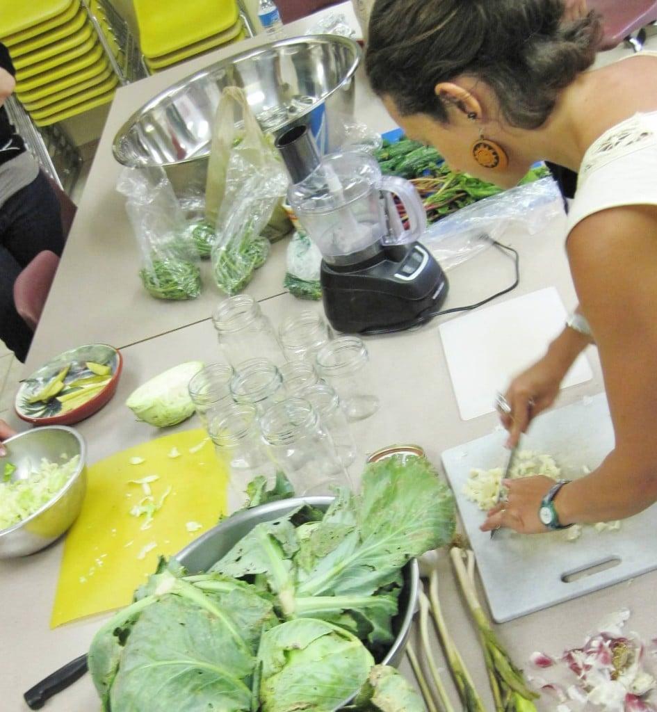 Grow Appalachia participant Adrienne Cedarleaf preps the garlic
