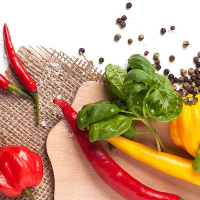 best tasting peppers habanero cayenne and basil on cutting board