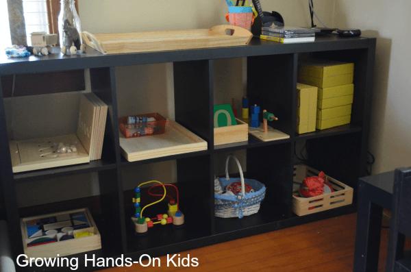 tot-school shelves in Montessori inspired space.