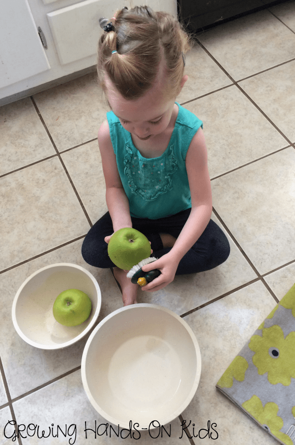 Letter A Apple Washing practical life activity.