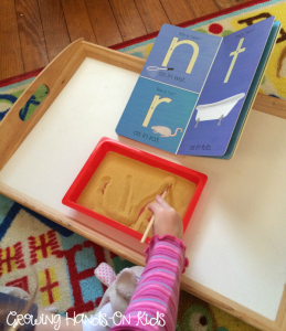 Letter T activities, sand tray writing for pre-writing skills.