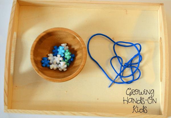 Stringing bear beads for letter B activities for tot-school.