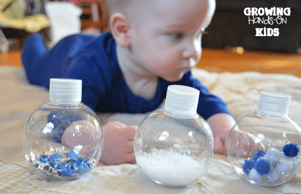 Winter discovery bottles for baby tummy time play.