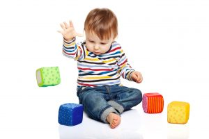 Baby with soft blocks, Activities to Promote Pincer Grasp.