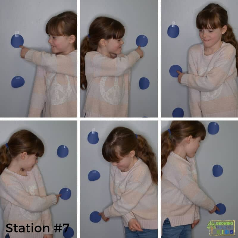 little girl completing station 7 activities for the sensory motor walk stations.