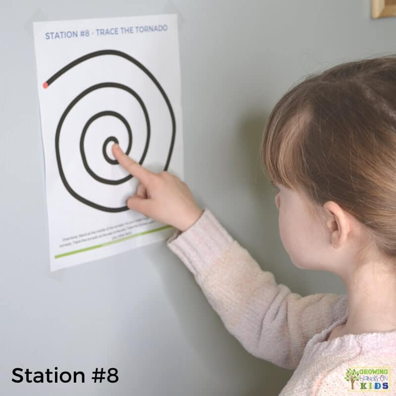 little girl completing station 8 activities for the sensory motor walk stations.