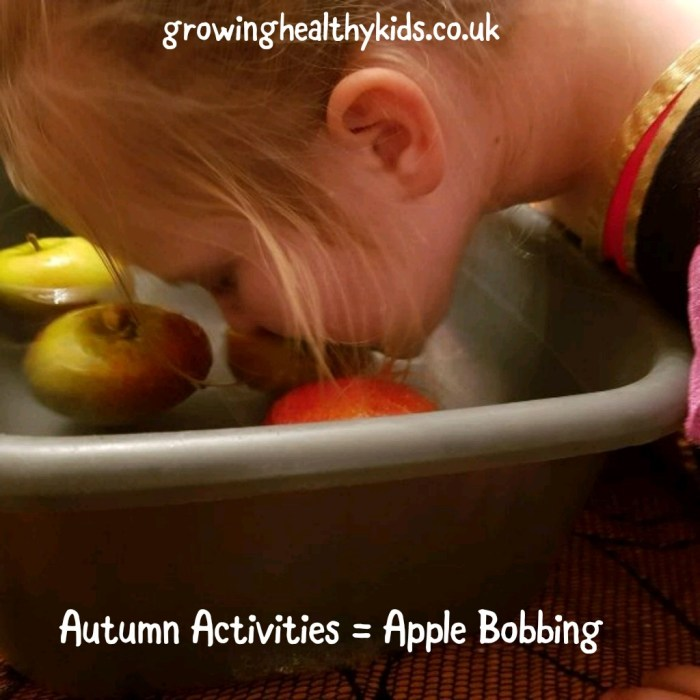 Apple bobbing with kids is a traditional way to celebrate apples and Autumn. Also a good activity for Halloween. Perfect activity for toddlers to adults.