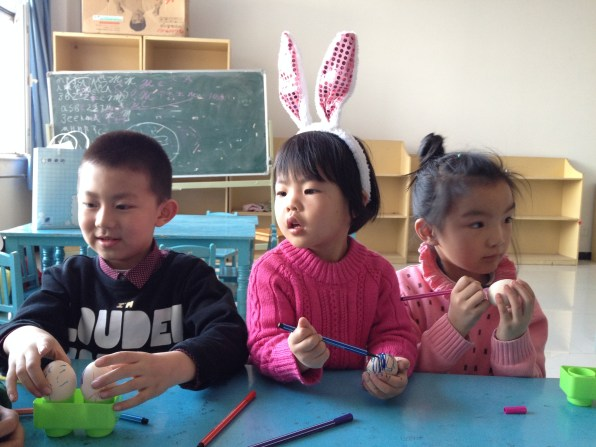 Some of the kids decorating Easter eggs (a first for most!)