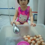 Water play with plastic eggs