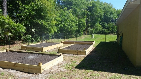 completed raised bed with soil