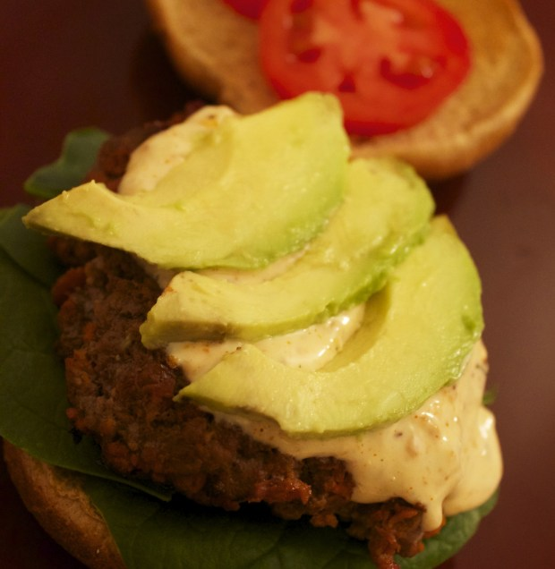 Thin avocado slices top this delicious chorizo burger with blue cheese chipotle sauce