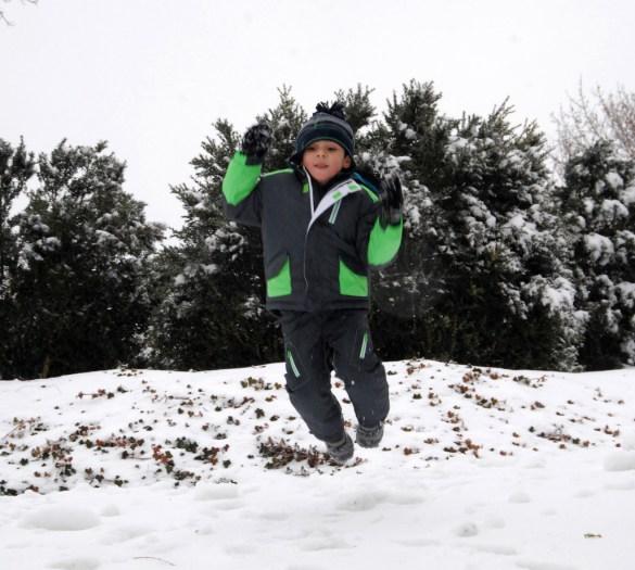 boy jumping in snow
