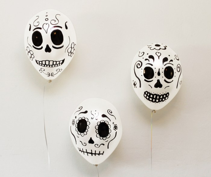 We got some white balloons and added some intricate skull designs using a black permanent market. These where so simple to make and they looked great! The best part was how easy and affordable these where and it only took a few minutes to make them.