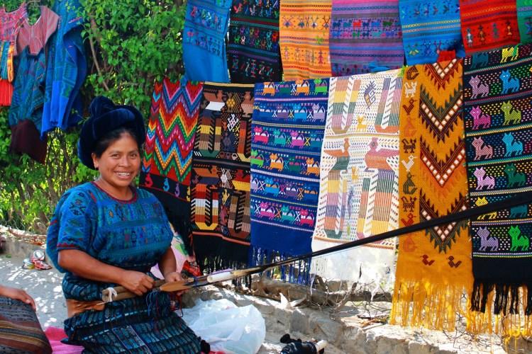 Mayan woman in Santa Catarina Palopó working on her beautiful embroidery. Atitltan, Guatemala.