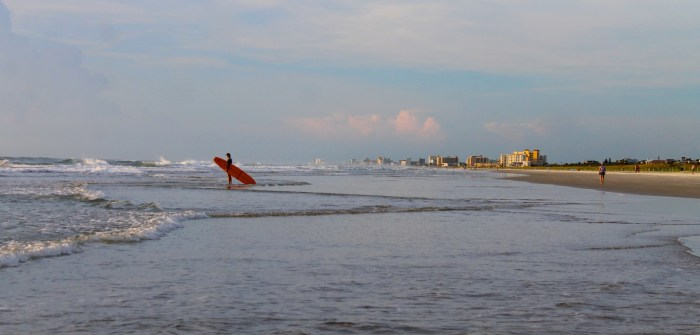 New Smyrna Beach surfer at sunrise