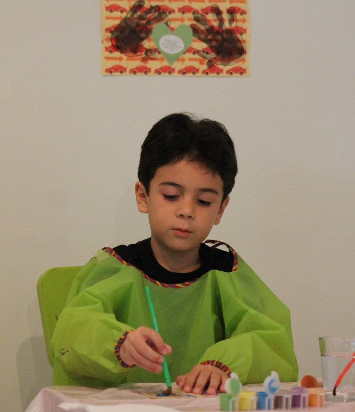 boy doing crafts