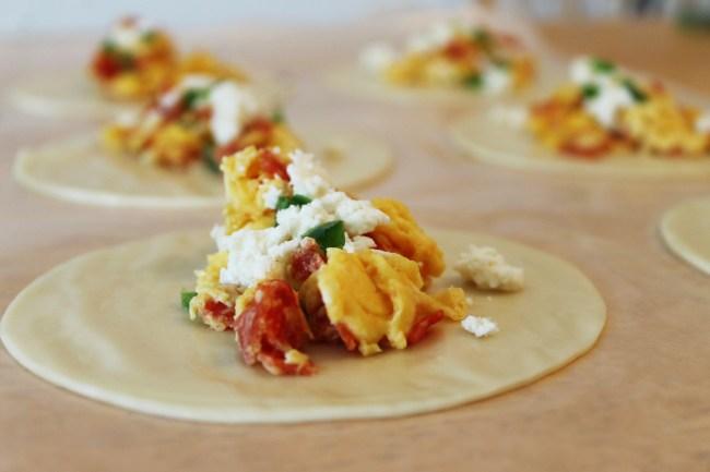 egg empanadas being assembled