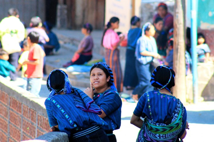 mayan women wearing traditional guipiles in San Antonio Palopo Guatemala
