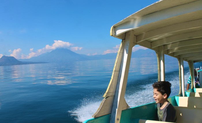 enjoying the view of the volcanos from water taxi in lake Atitlan
