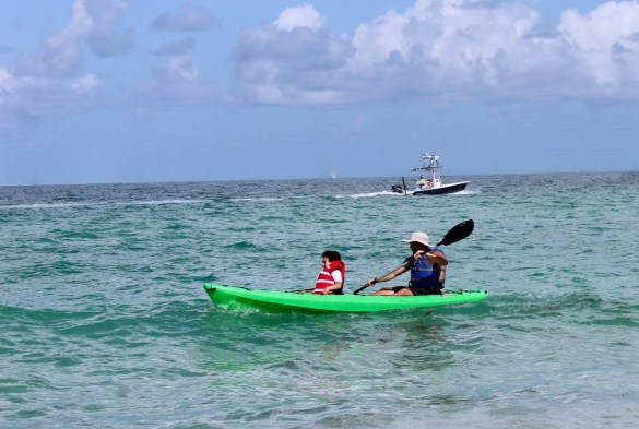 dad and son in kayak