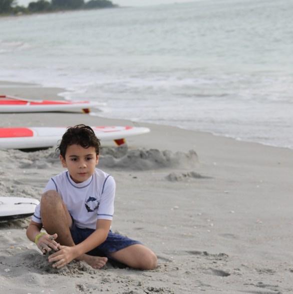 boy on Sanibel beach at South Seas Island Resort