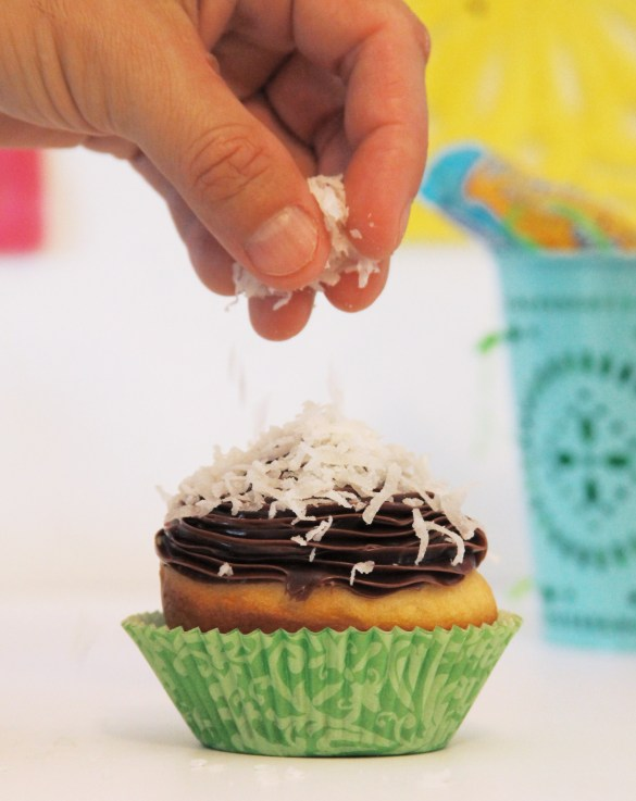 adding Coconut on the cupcakes