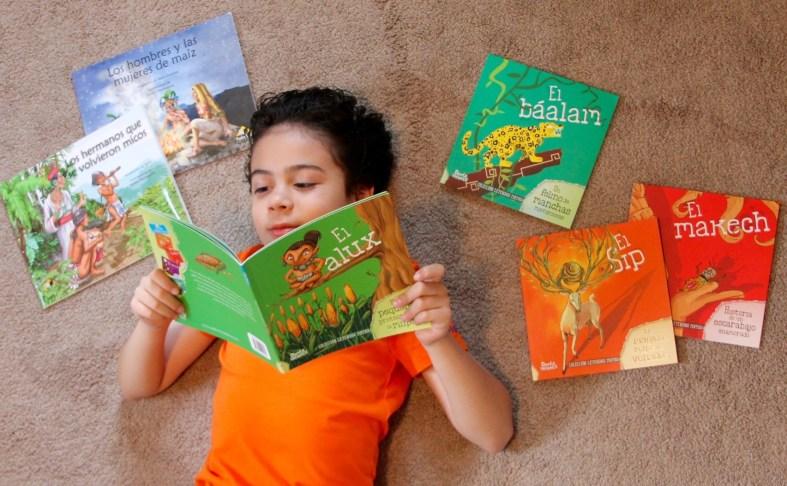 boy reading books in Spanish