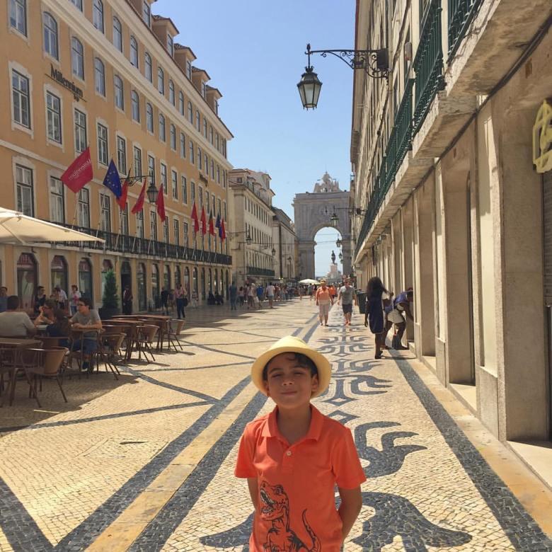 boy on Lisbon's Rua Augusta