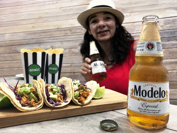 Enjoying Modelo beer woman