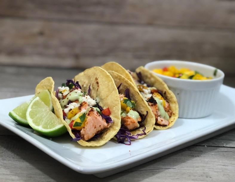 Chipotle Salmon Tacos With Mango Salsa And Avocado Crema