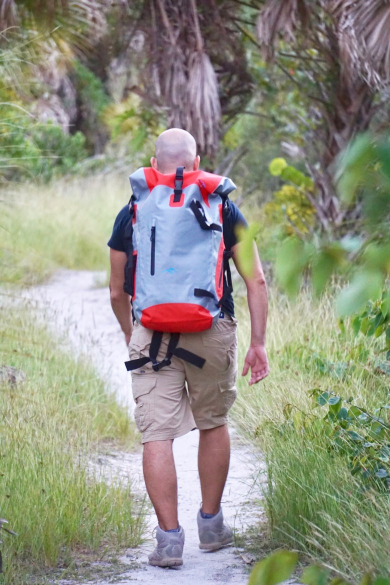 Hiker with waterproof backpack