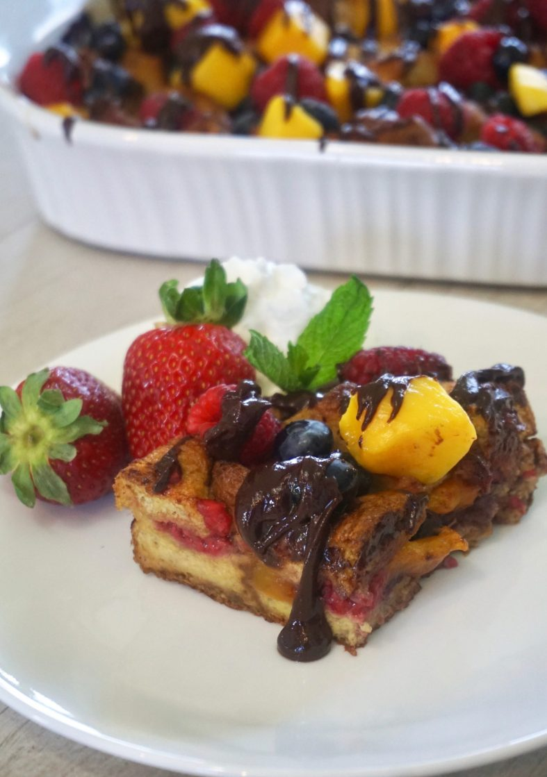Easy berries and mango french toast casserole with chocolate drizzle