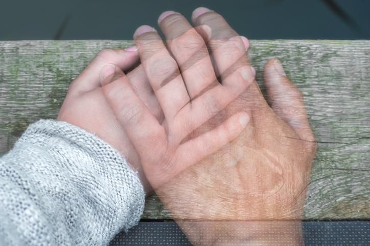 Young and elderly hands touching