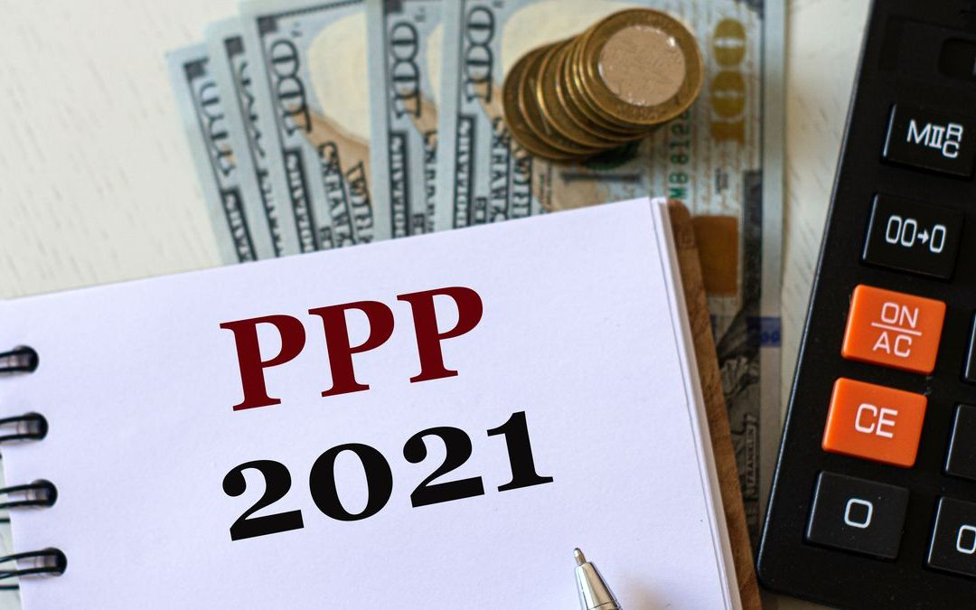 ppp guide on notebook with calculator and money