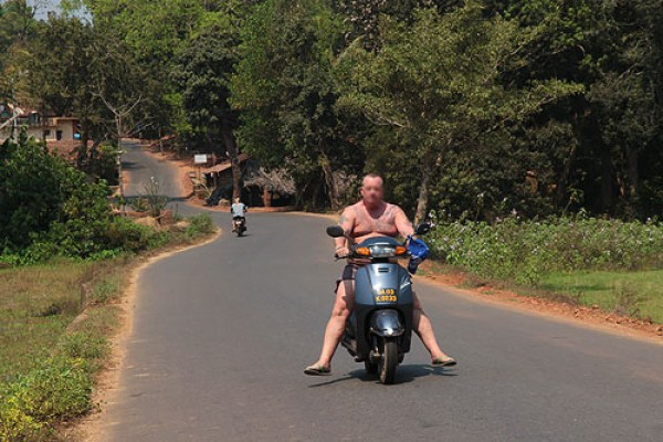 fat man on moped