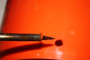 A hot soldering iron can make holes in plastic buckets easily and without splitting.