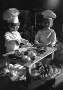 Autonomon bakers in a Dusseldorf shop window prepare for Christmas