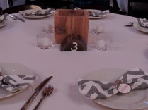 Each table number was made from an old tree out of the backyard and my grandpa made all of the planters. It was a team effort.