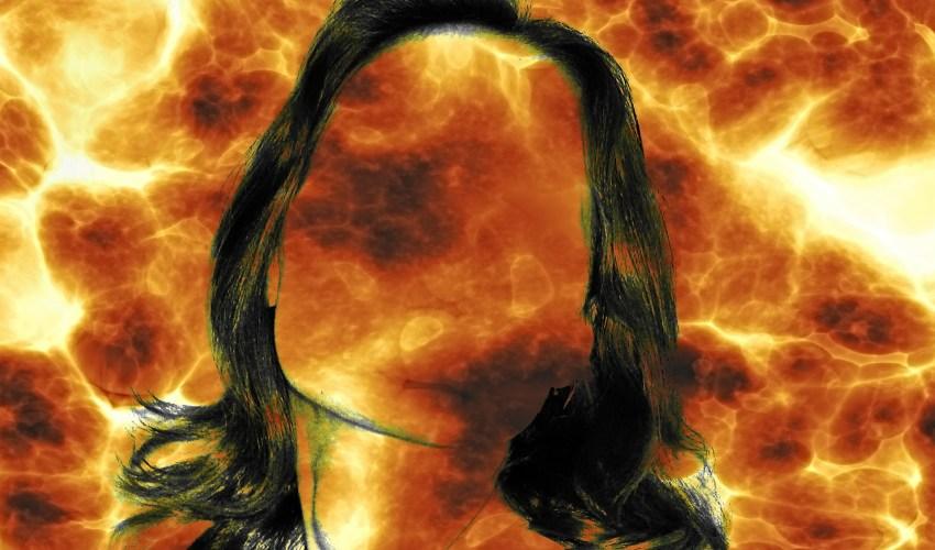 silueta de una mujer sobre un fondo de llamas Imagen de Gerd Altmann en Pixabay