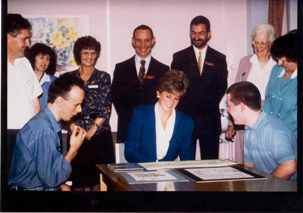 Second official visit to Mildmay when Princess Diana met Kevin and he presented her with some of his own water colours