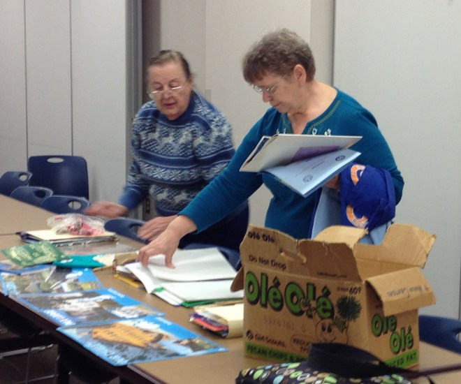 Committee members Joan Paull (left) and Ginger Holinka select items for display.