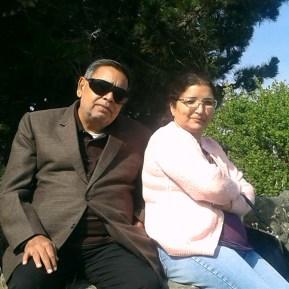 Mommy and Papa sitting near the Marina