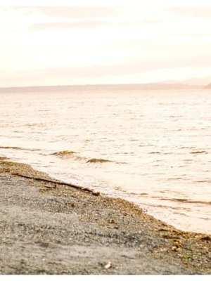alki beach engagement session seattle beach at sunset couple orange sunset
