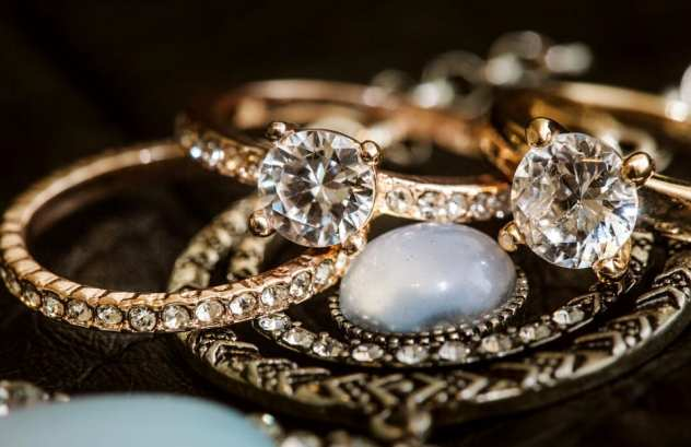 snohomish wedding photography lgbtq wedding rings with moonstone detail photo by gsquared weddings