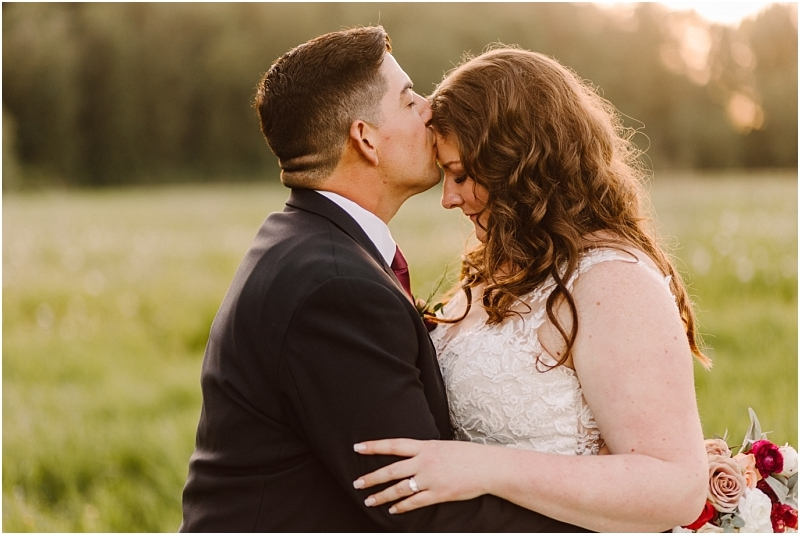 marionfield farm wedding sunset photos of bride and groom with bridal bouquet