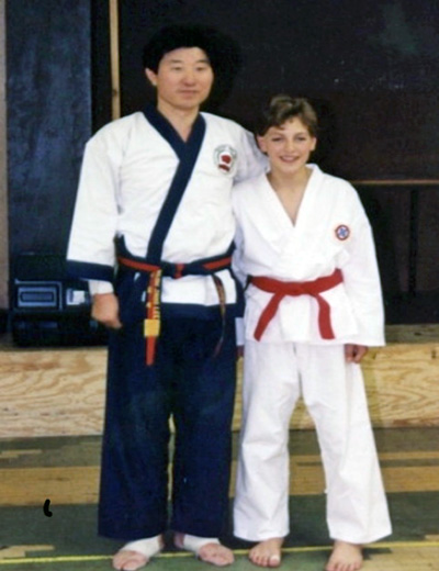 B J Lee and a young Master Auciello in a Mid-west Dobok