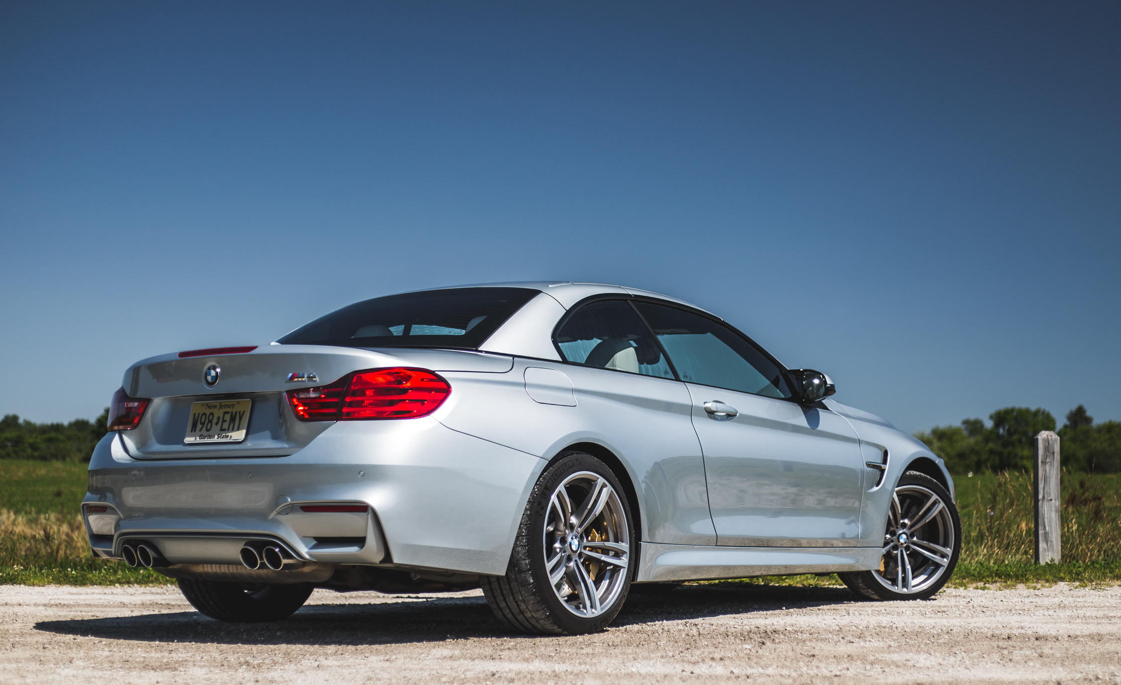2015 BMW M4 Convertible Top Up Exterior Rear and Side