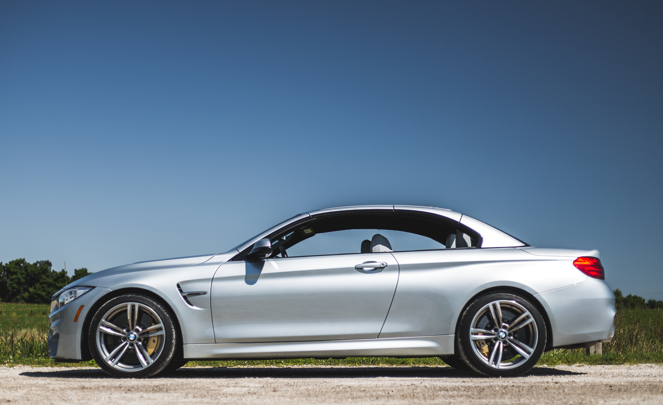 2015 BMW M4 Convertible Top Up Exterior Side